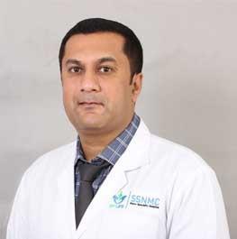 Dr Nikhil  B