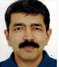 Dr Arvind Mittal